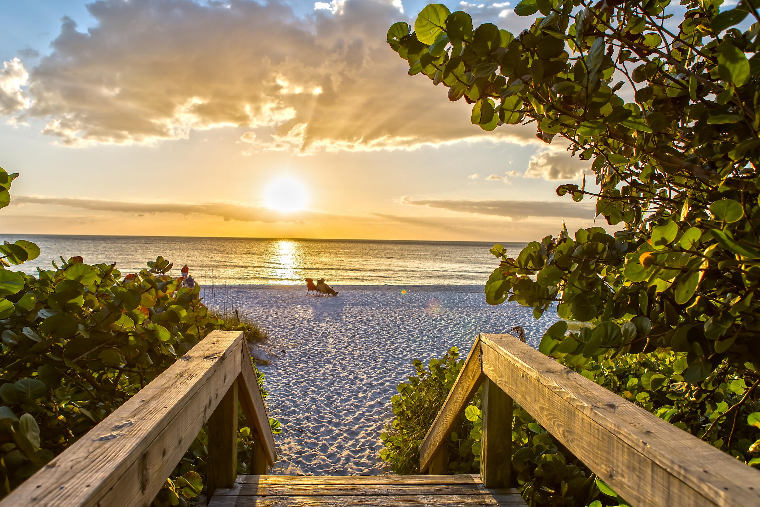 shutterstock_567581344_Naples_Beach_walk-1